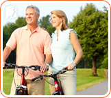 A couple riding bicycle: healthy practices can help to avoid or reduce dizziness during menopause