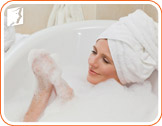 Woman in a tub: take hot showers prevents and relieves menopause dizziness