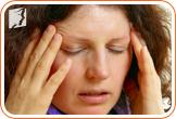 Woman with headache: it's common for menopausal women to have headaches caused by fatigue