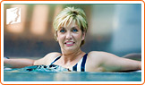 Woman in a pool: swimming can help to control hormone levels and prevent breast pain