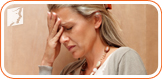 Woman feeling dizzy: fatigue and dizziness are common menopause symptoms.