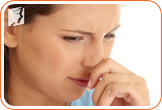 Menopausal woman experiencing fatigue and nausea