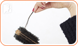 Strand of hair in the brush: hair loss is common during perimenopause