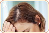 Concerned woman: hair loss is a common menopause symptom