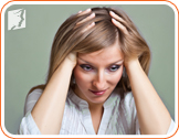 Annoyed woman: emotional stress can be a cause of hair loss