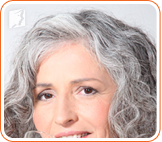 Gray-haired woman: hair thinning is a common sign of aging