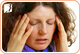 Woman holding her head: many menopausal women report experiencing migraines and headaches