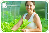 Woman gardening: lifestyle changes and stress reduction are the best way to treat headaches