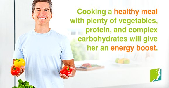Cooking a healthy meal with plenty of vegetables, lean protein, and complex carbohydrates will give her an energy boost.