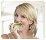 Woman eating an apple: simple changes in lifestyle can reap huge benefits in fighting headaches
