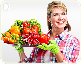 Woman with vegetables: a healthy diet can help fight mood swings