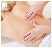 Woman getting a massage: massages can help alleviate muscle tension