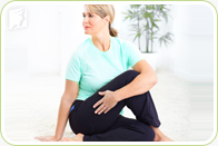 Woman practicing yoga to relieve early menopause symptoms