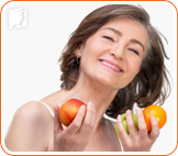 Menopausal woman holding fruits to combat tingling extremities