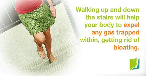 Walking up and down stairs will help your body expel any gas trapped within, getting rid of bloating