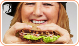 Woman eating a sandwich: during menopause, it can be difficult to maintain the same weight