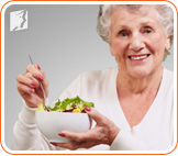 Woman eating a salad: It's very important to eat healthy during menopause